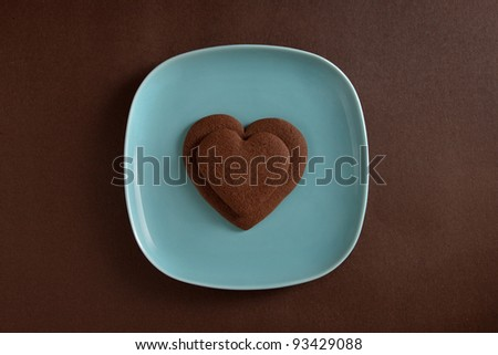 Two heart shaped chocolate cookies on a plate
