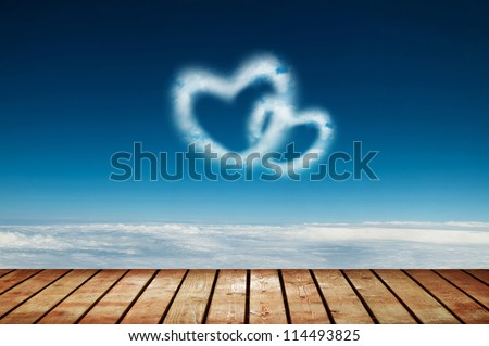 Two heart shaped clouds in the blue sky