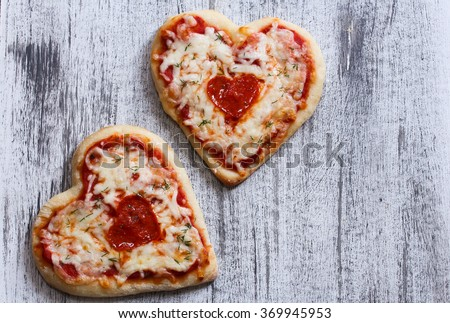 Two heart shaped pizzas with copy space / Valentine heart pizza top down view