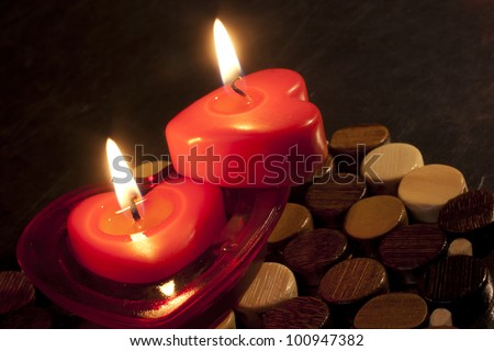 Two heart shaped red candles