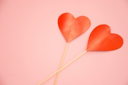 two hearts lie on a pink background. valentine's day concept. High quality photo.