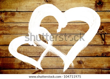 Two hearts love symbol painted on old wooden yellow wall background
