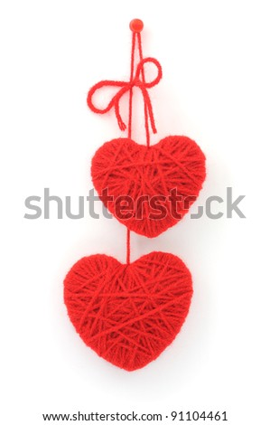 two hearts made of red wool yarn