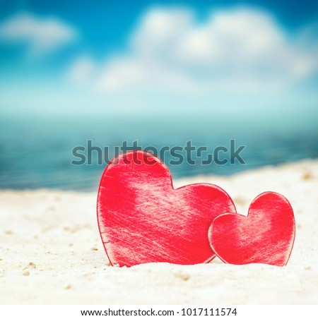 Two hearts on the summer beach. Valentines day.