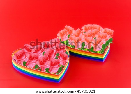 Two  hearts, paint  of a six-colour gay flag on red background filling of pink  roses.