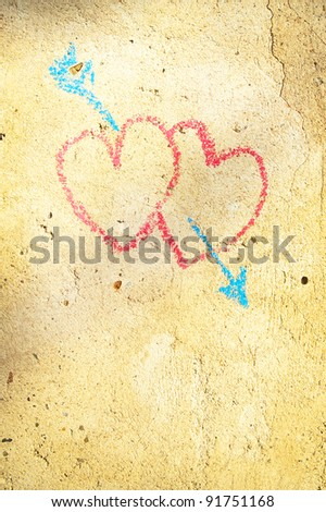 two hearts stricken by an arrow as a symbol of love on the wall