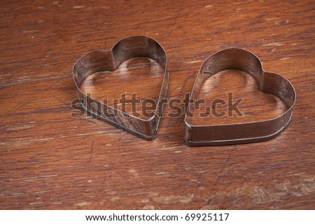 Two hearts, Two silver heart shape put together.