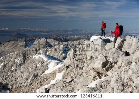 Two hikers climbing on Grosser Priel mountain in Austrian Alps (Totes Gebirge)