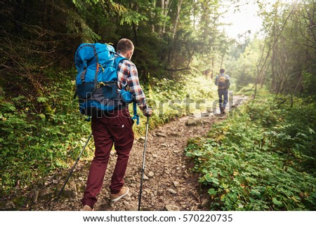 two hikers walking along a...