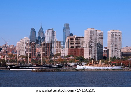 """Two Historic ships, the square-rigged sailing ship """"Mosholu"""" and the cruiser USS Olympia, are moored at Philadelphia's Penn's Landing"""