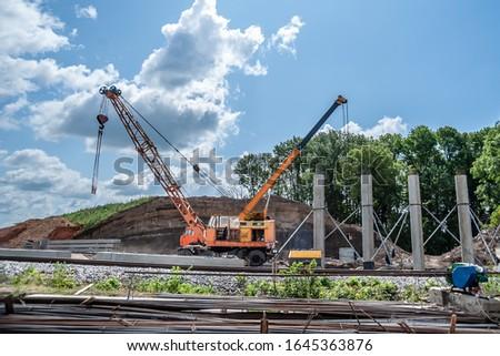 Two hoisting cranes on a bridge construction