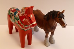 Two horses together. Toys not real one. Wooden and plastic. Close-up and isolated on a white background. Stockholm, Sweden.