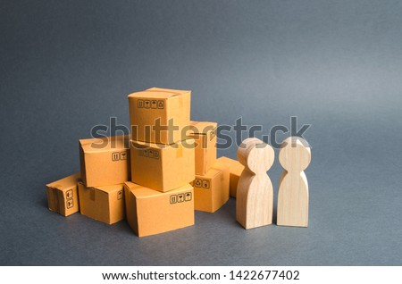 Two human figures stand near a pile of craton boxes. the buyer and the seller, the manufacturer and the retailer. Discussion of terms of trade, purchase of goods and services. Business and commerce