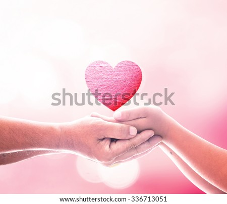 Two human hand hold red heart. Valentines Day Love Christmas Organ Donation Marriage Gift Generosity Harmonious Gift Hope Share Dream Wish Dating World Cupid Giving New God Graft Family Cancer concept