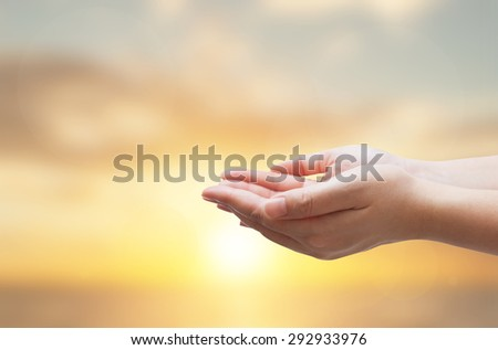 Two human hands holding  for subject on sunset background #292933976
