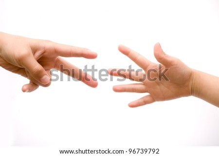 Two human hands stretching out towards one another over a white background in a concept of help and assistance