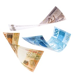 two hundred, one hundred and fifty reais notes in fall, isolated white background. Concept of big loss, inflation and devaluation