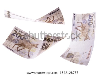 two hundred reais banknotes from brazil falling on isolated white background, new banknote from brazil