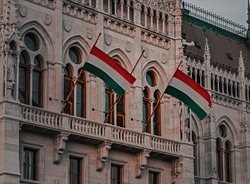 Two Hungarian flags on the parliament building . BUDAPEST, HUNGARY