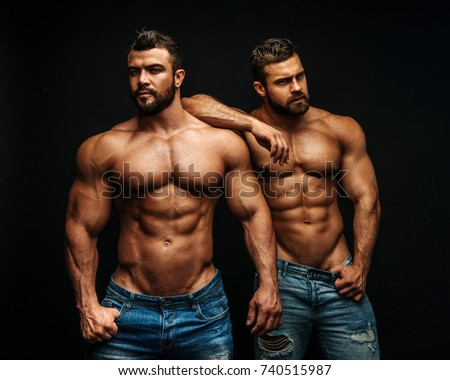 Two hunks standing at black background #740515987