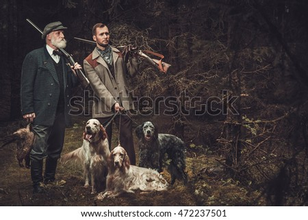 two hunters with dogs and...