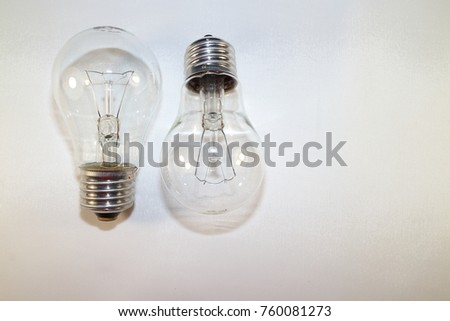 two incandescent lamps close-up on a white background #760081273