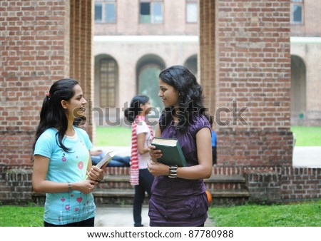 Two Indian college girls talking to each other.
