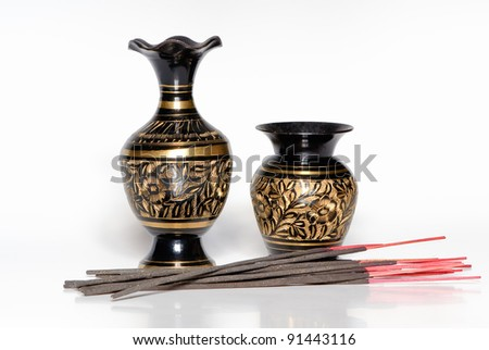 Two Indian vases with aroma sticks - stock photo