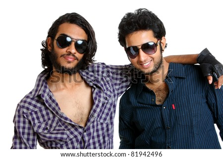 Two Indian young man posing casually to the camera.