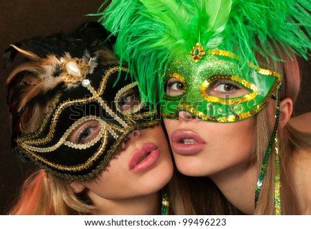 Two International beauty pageant winners posing sexy in lingerie and carnival masks