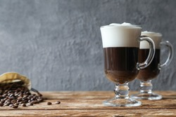 Two Irish coffees with coffee beans on the table