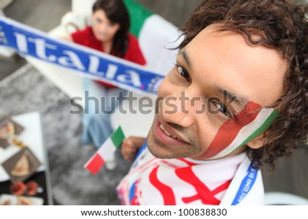 Two Italy fans watching match at home
