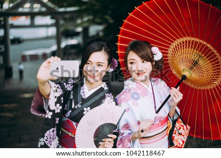 Two japanese girls wearing kimonos traditional clothes, lifestyle moments #1042118467