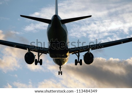 Two jet engine aircraft in sunset
