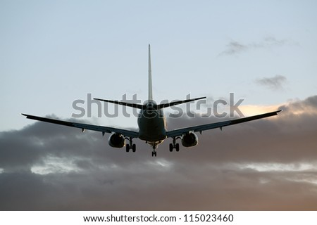 Two jet engine aircraft in sunset - stock photo