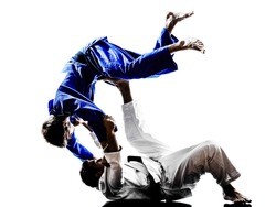 two judokas fighters fighting men in silhouettes on white background