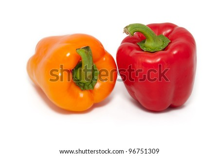 two juicy bell peppers on a white background