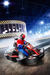 Two kart racers are racing on the grand track motion