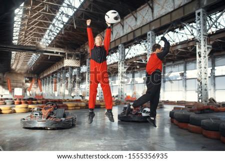 Two kart racers celebrates victory, karting #1555356935