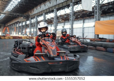 Two kart racers enters the turn, front view #1555357052
