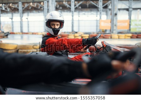 Two kart racers fight for victory, side view #1555357058