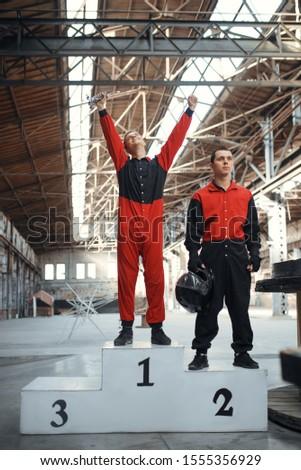 Two kart racers on podium, winners, karting #1555356929