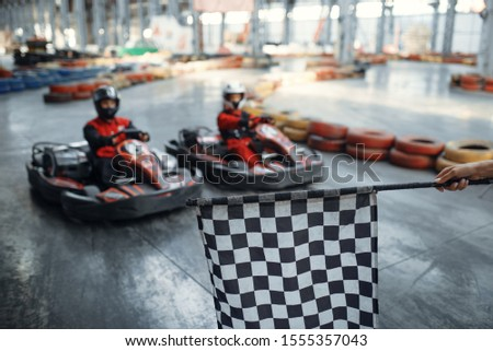 Two kart racers on start line, checkered flag #1555357043