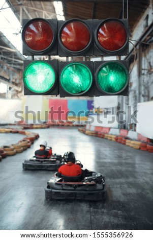 Two kart racers starts race, green traffic light #1555356926