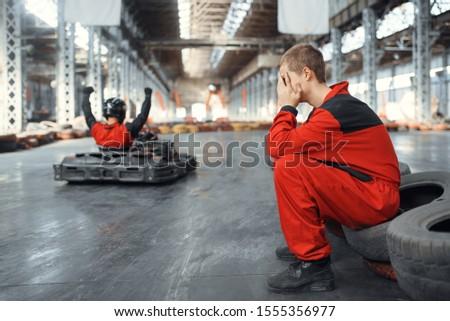 Two kart racers, winner and looser, karting #1555356977