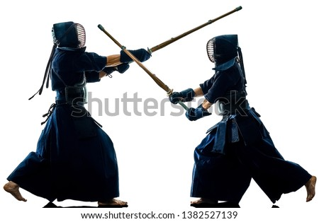 two Kendo martial arts fighters combat fighting in silhouette isolated on white bacground Stock fotó ©