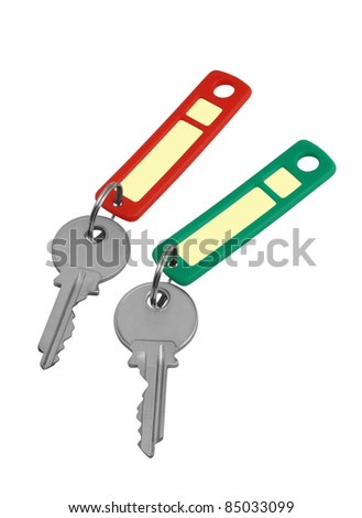 Two keys with red and green labels isolated on white  / Two keys with red and green labels