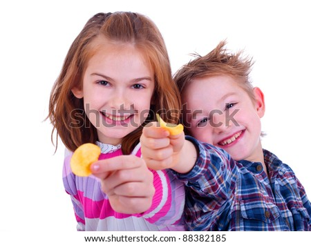 Two kids and chips snack