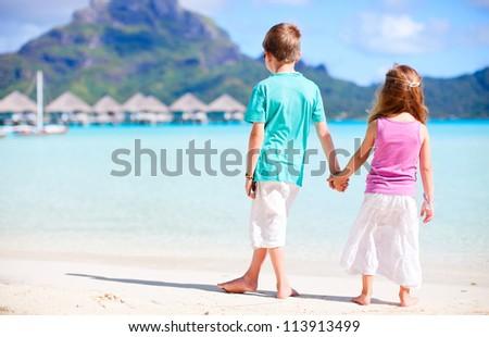 Two kids at the beach on Bora Bora island
