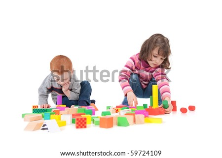 Two kids building block towers. Isolated on white with shadows